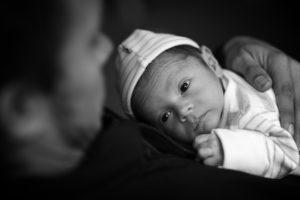 man-holding-newborn