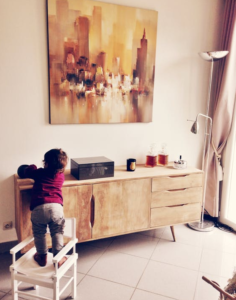 child climbing on furntiure