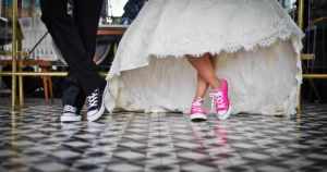 pink converse with wedding dress