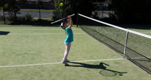 child playing tennis