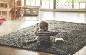 child sitting on a rug